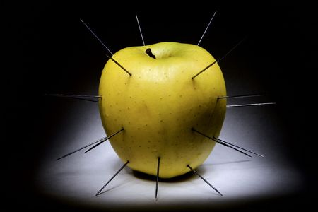 spiked: spiked apple isolated on black