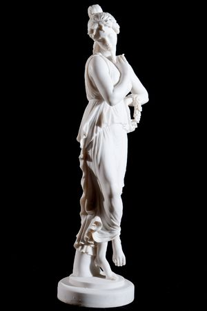 White classical marble statue of a woman with circlet of flowers   isolated on black Imagens