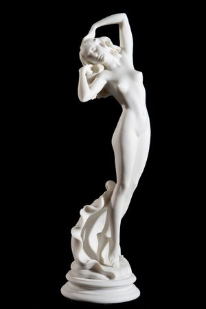 Classical white Aphrodite statue isolated on black background
