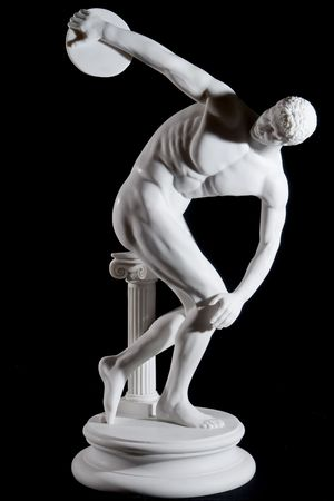 Classical white marble statue of naked discus thrower isolated on black background Stock Photo - 4577042