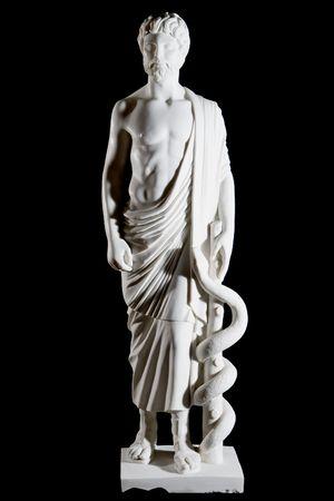 アスクレピオスの古典的な像分離黒の背景に白い大理石 写真素材