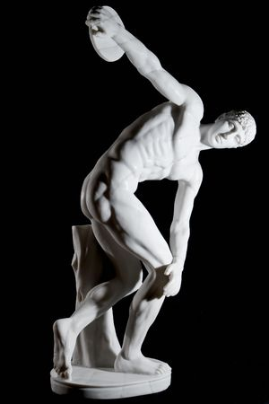 Classical white marble statue of discus thrower isolated on black background photo