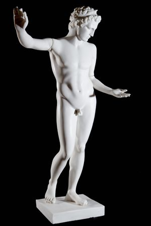 Classic white marble statue of Apollo isolated on black background Stock Photo