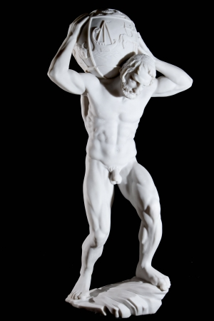 White classic statue of titan Atlas isolated on black background photo