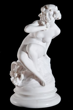 Classic white marble statue of Demeter isolated on black background
