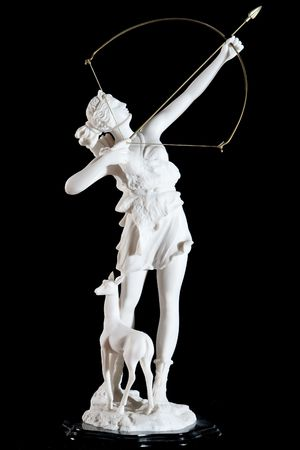Classic white marble statuette of Artemis isolated on black background
