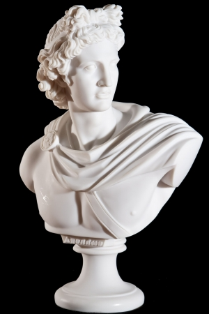 bust: Classical marble white Apollo Bust isolated on black background