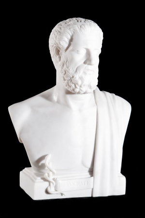 Classical white marble bust of Hippocrates isolated on black background