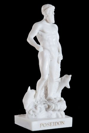 Classical white statuette of Poseidon isolated on black background