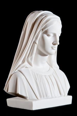 Classic white marble bust of Mary (mother of Jesus) isolated on black background Stock Photo
