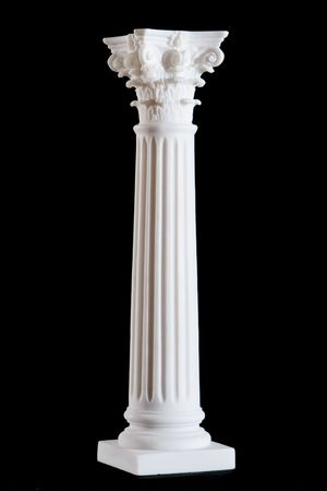 Classical white marble column isolated on black background