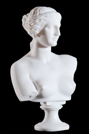 classic woman: White marble bust, part of classic statue Aphrodite of Milos isolated on black background