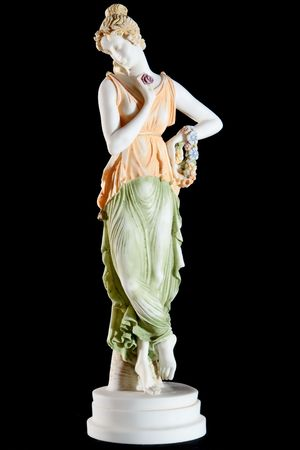 Classic painted marble statue of a woman isolated on black background