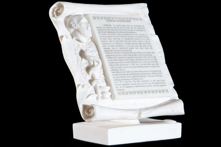 oath: Classical white marble Hippocratic Oath isolated on black background