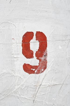 wreckage: Number on weathered old white wall