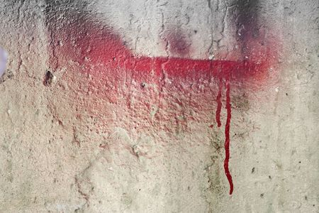 Weathered damaged wall with red paint Stock Photo - 4577104