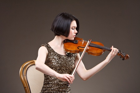 Girl with violin in gold dress photo