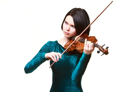 Girl in green dress with violin isolated on white photo