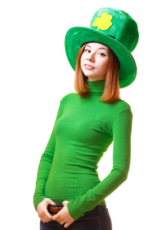 saint patrick's day: Red hair girl in Saint Patrick s day hat isolated on white background