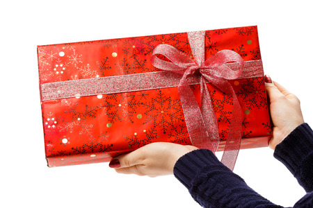 hands with christmas gift isolated on white background