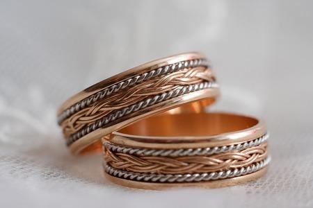 wedding rings: Beautiful wedding rings on white background macro Stock Photo