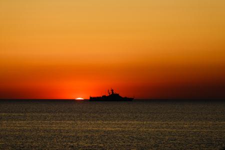guard ship: russian coast guard ship at sea during sunset Stock Photo