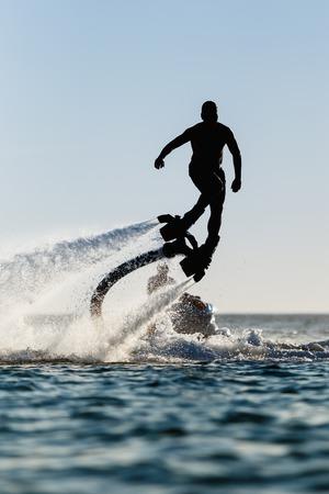 海でフライ ボード ライダーのシルエット 写真素材