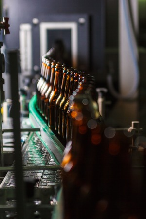 conveyors: Brown beer bottles on the conveyor belt