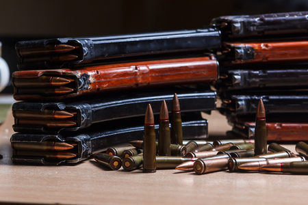 ammo: 7.62 ammo for machine guns with loaded magazines on table