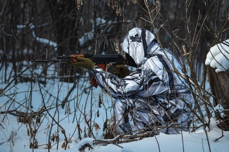 guerrilla warfare: Soldier with the russian machine gun in snow outdoors, hero shoot