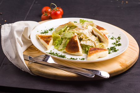 vegeterian: Concept: healthy food. Homemade Vegeterian salad with fried cheese on white plate with ingredients bread and cutlery around Stock Photo