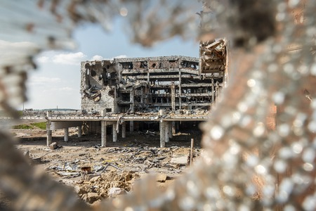 broken through: Wide Angle view of donetsk airport ruins through broken glass after massive artillery shelling