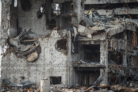 artillery shell: Detail view of donetsk airport ruins after massive artillery shelling Stock Photo