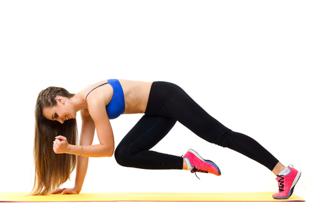 Concepts: healthy lifestyle, sport. Happy beautiful woman fitness trainer working out with yoga mat isolated on white background