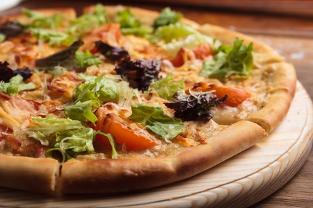 gluttony: Concept: restaurant menus, healthy eating, homemade, gourmands, gluttony Caesar pizza on messy wooden background Stock Photo