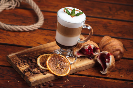 gluttony: Concept: restaurant menus, healthy eating, homemade, gourmands, gluttony. Latte with sweets on messy vintage weathered wooden table.