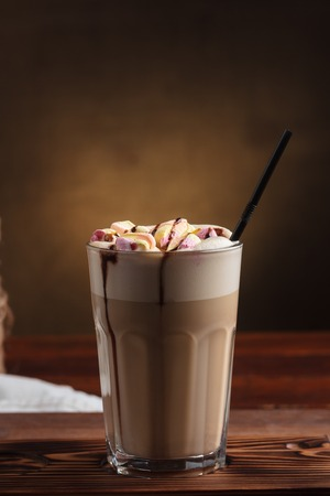 gluttony: Concept: restaurant menus, healthy eating, homemade, gourmands, gluttony. Hot latte with marshmallows with sugar on vintage wooden table.