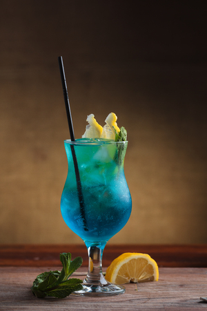 Concept: restaurant menus, healthy eating, homemade, gourmands, gluttony. Blue Lagoon Cocktail on gritty vintage background Imagens
