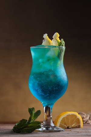 Concept: restaurant menus, healthy eating, homemade, gourmands, gluttony. Blue Lagoon Cocktail on gritty vintage background Stock Photo