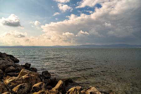 View of Bracciano lake with cloudy sky - Anguillara (Italy)