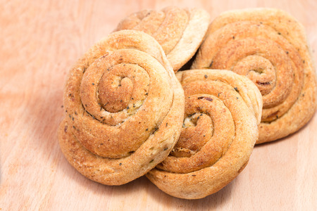 Four wholemeal buns with onions