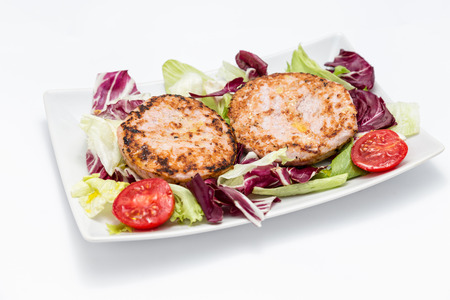 Chicken burgers over salad - Two burgers, chicory, lettuce and tomato