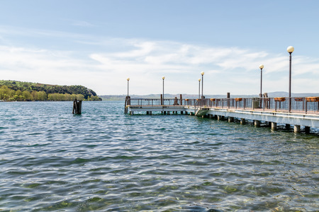 View of the jetty from the shore of Lake Bracciano Anguillara Lazio Italy Archivio Fotografico