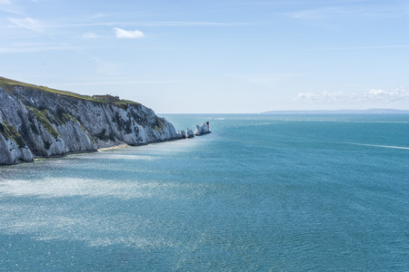 extremity: The Needles - is a row of three distinctive stacks of chalk that rise out of the sea off the western extremity of the Isle of Wight, UK, close to Alum Bay.