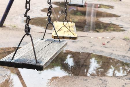 chain swing ride: Closeup Empty swing for children on garden park, Empty feeling concept