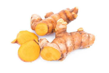 peppery: Closeup turmeric roots slices on white background