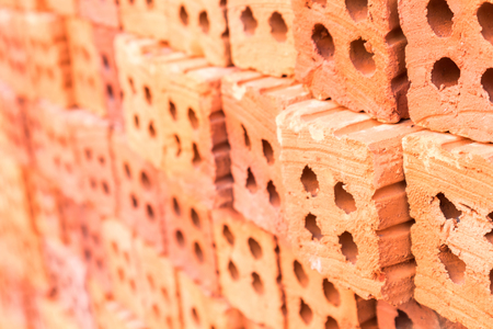 Closeup Group of blend red brick material for industry , selective focus