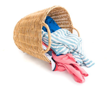 Clothes on wicker baskets for washing preparations whit white background, workhouse concept Stock Photo