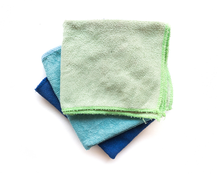 Pile of microfiber cloth for clean on white background, workhouse concept