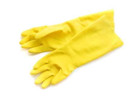 Yellow rubber gloves for cleaning on white background, workhouse concept